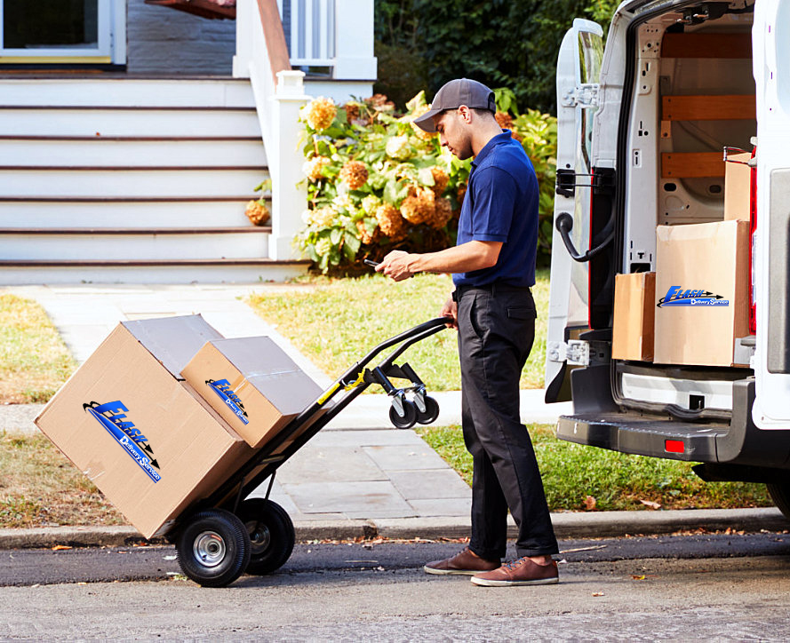 delivery man texting while pushing the cart