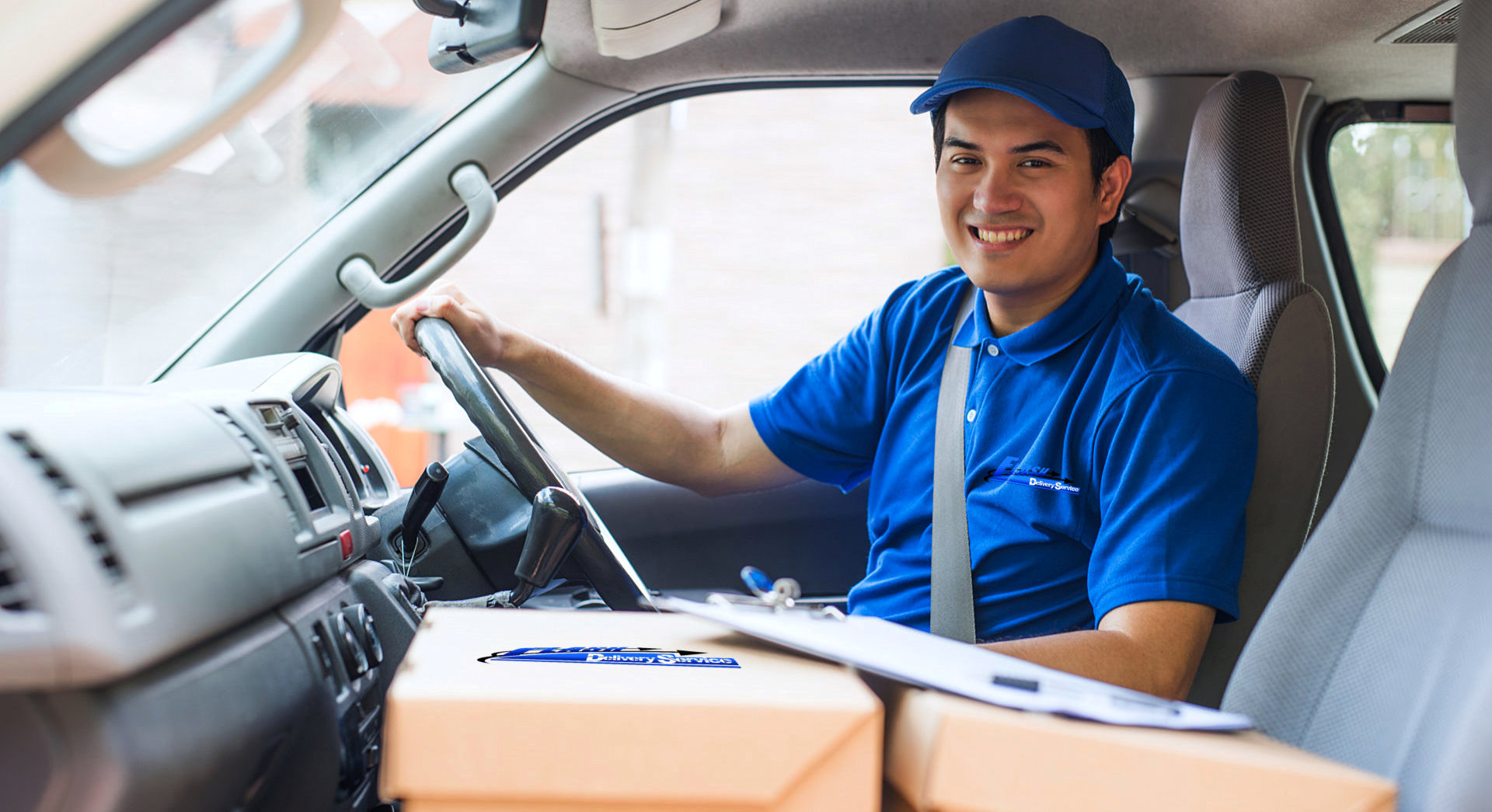 delivery man smiling inside the delivery van