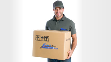 adult man carrying a box