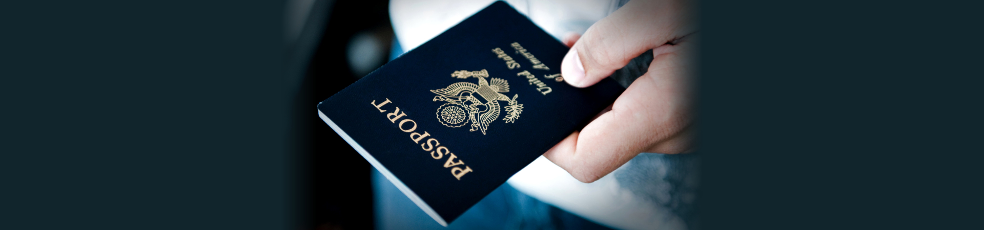 Image of someone holding a passport
