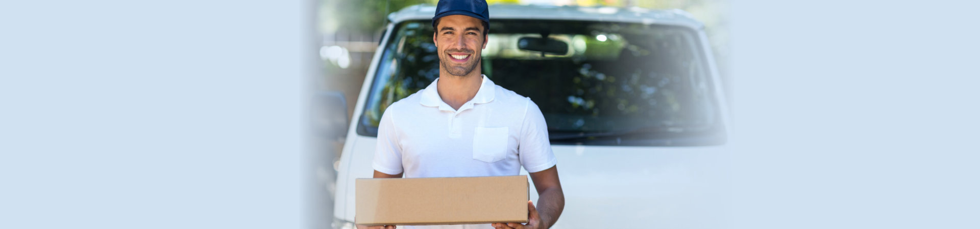 delivery man holding a box